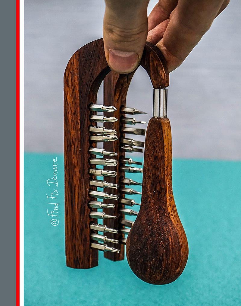 Handmade Wooden Screwdriver Set held in hand