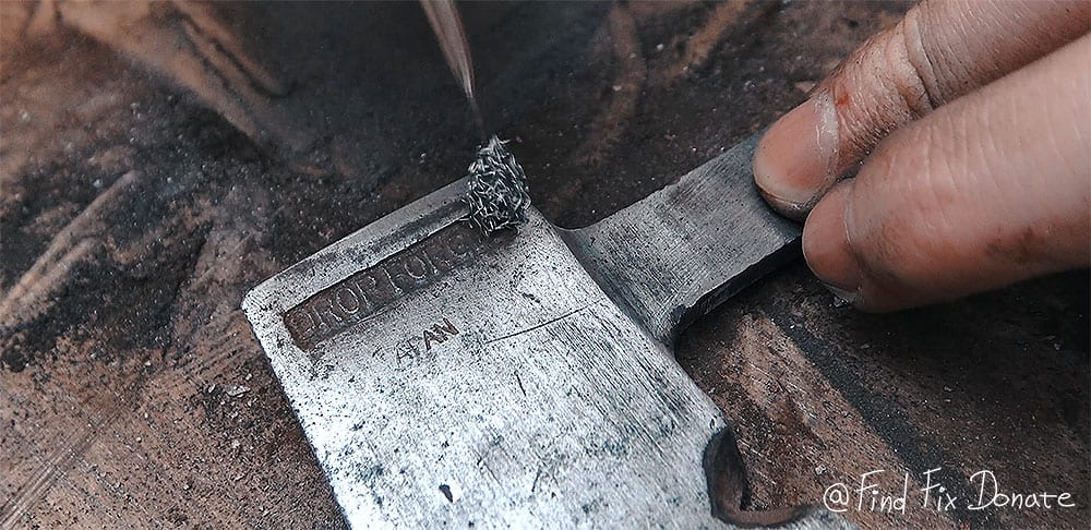 Japanese Axe while cleaning with steel brush