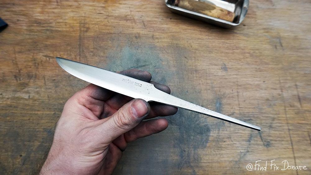 Knife's blade after long sanding.