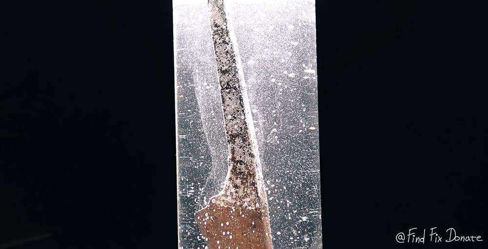 Rust and vinegar reacting in glass tube.