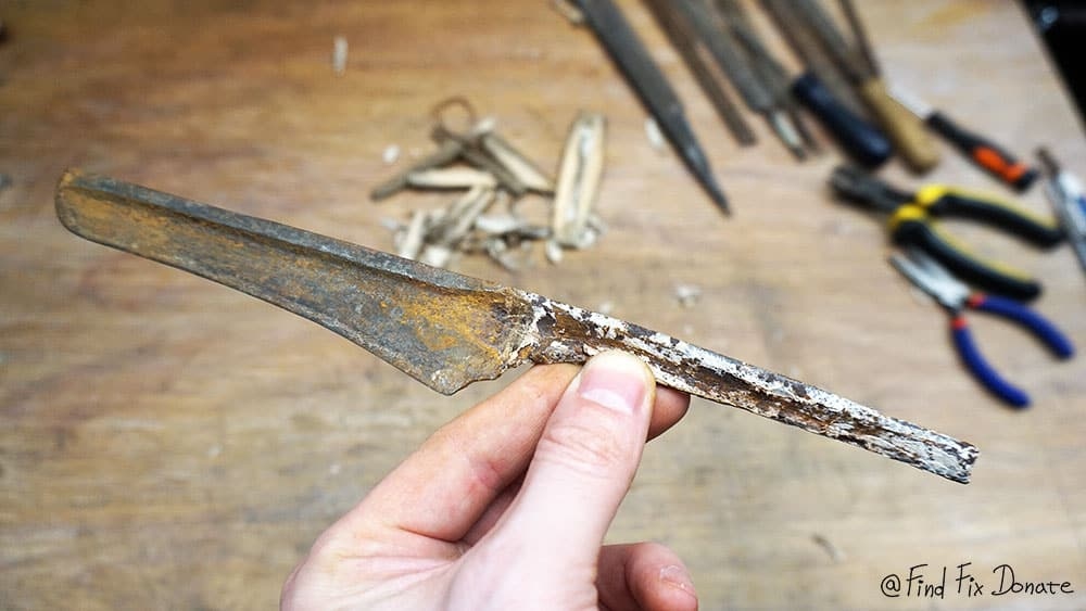 Disassembled old wicked knife.