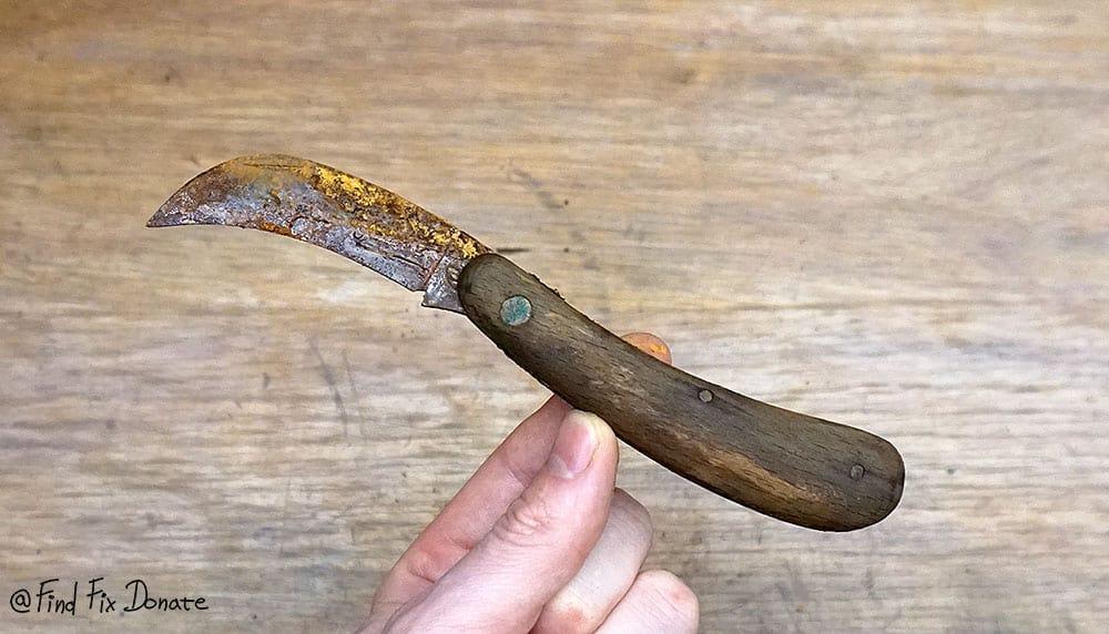 Old folding pocket knife after opening the blade.