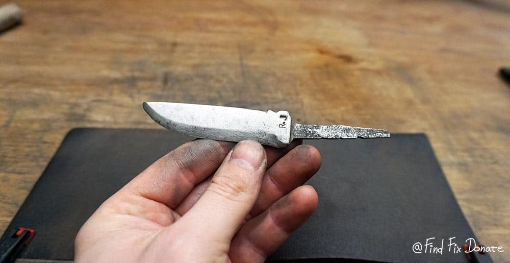 Old handmade knife blade with visible stamp R.J.