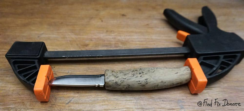 Old handmade knife is assembled and glued together.