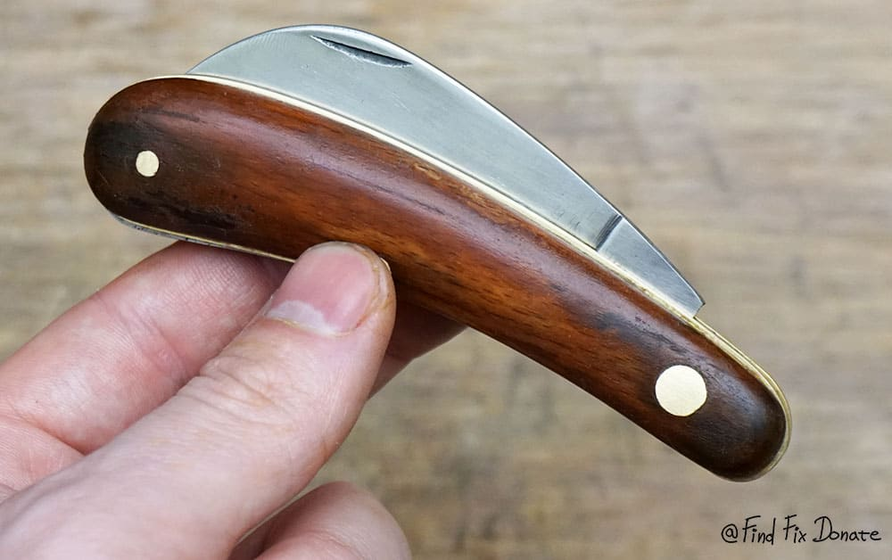 Handheld folding pocket knife.