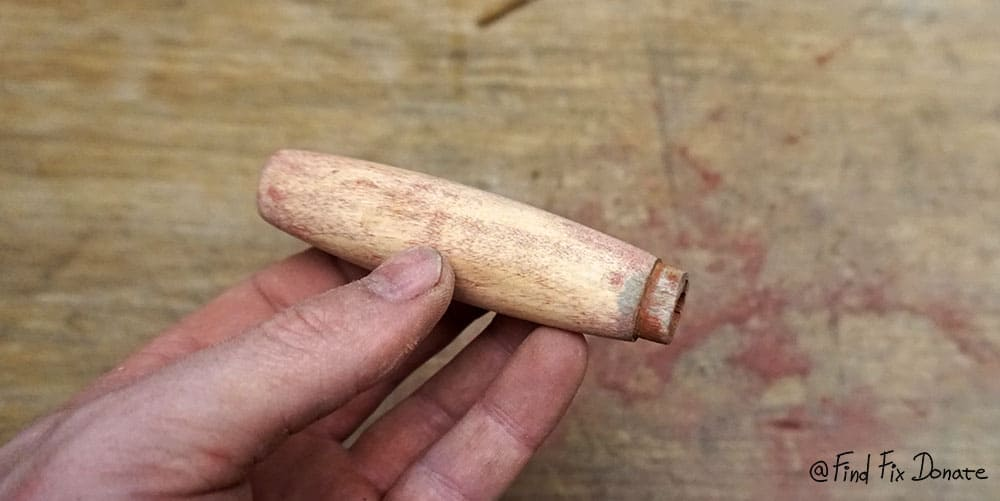 Removed old paint from wooden handle.