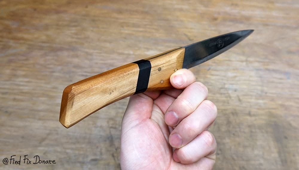 Here is how it looks in hand after scissors blade restoration and knife making out of it.