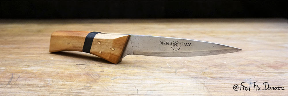 Restored scissors' blade and new wooden handle.