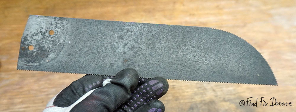 Saw blade cleaned with plain cloth.