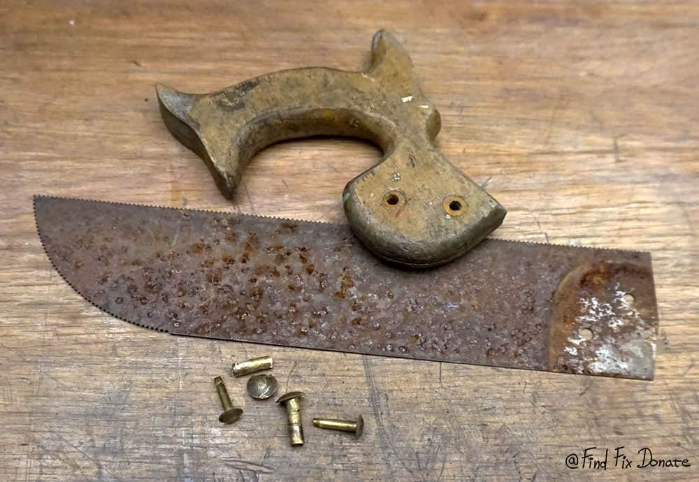 Disassembled old hand saw.