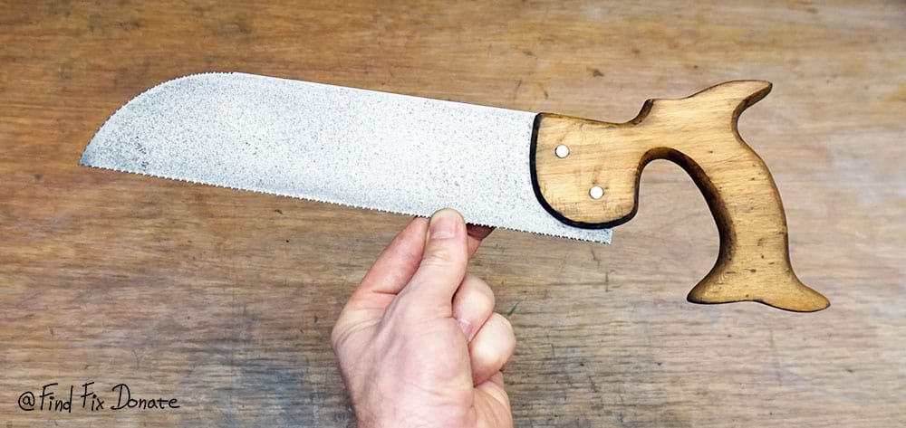 Restored old one and a half sided hand saw.
