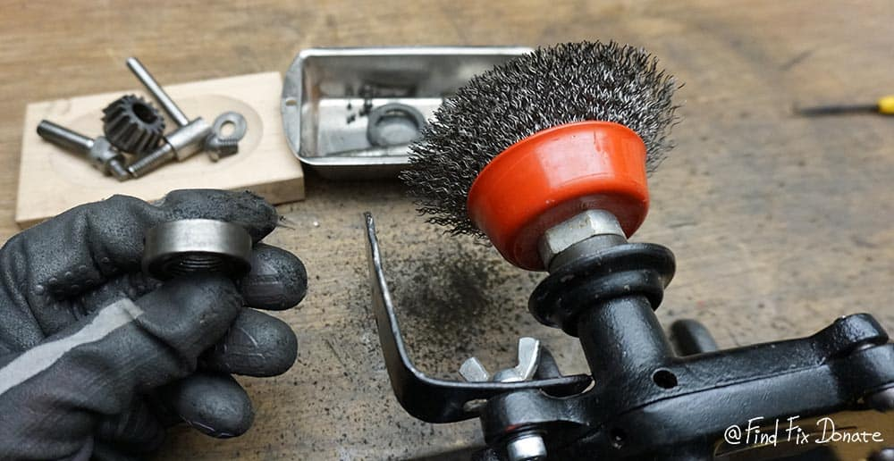 I was using hand cranked grinder with attached steel brush wheel to clean all non painted parts.