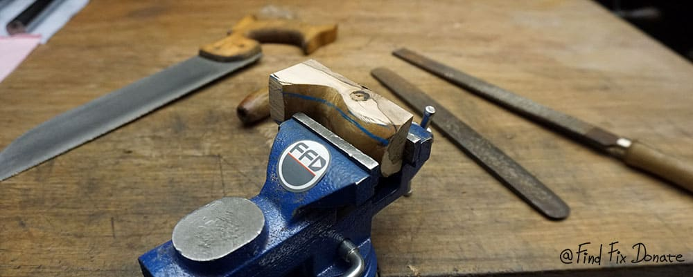 Shaping the handle for drill press.