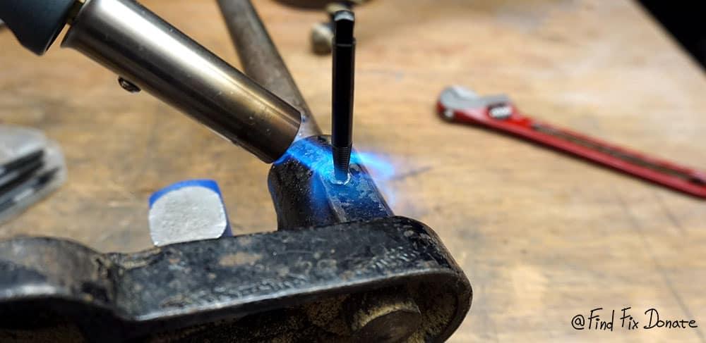 Heating the broken bolt.
