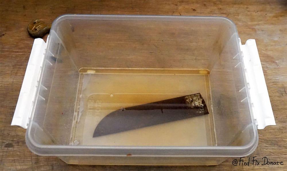 Placed saw blade in vinegar bath.