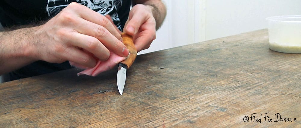 Finishing the handle with a homemade beeswax polish.