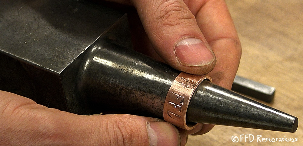 I made copper rings to attach on the handle in order to prevent handle cracking. I did branding on both rings as shown on the picture above.