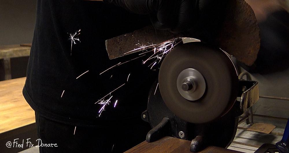 Grinding on hand crank grinder.