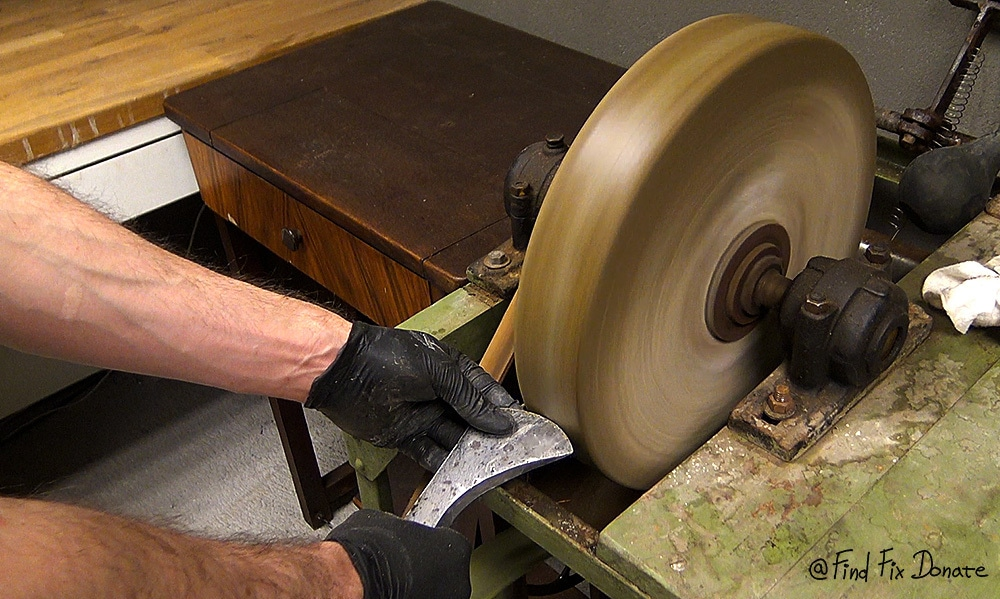 Reshaping the cutting edge on wet stone.