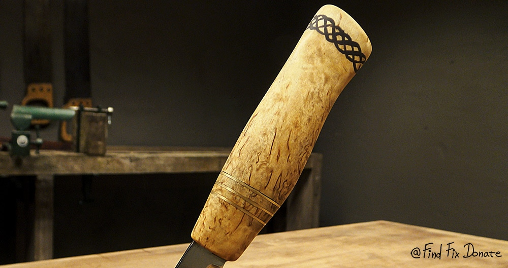 The curly birch wooden handle detail - knife making.
