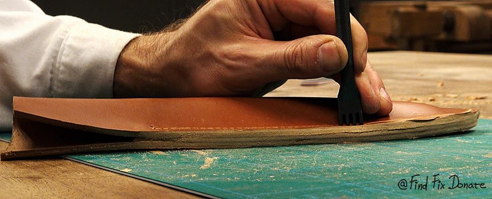 Making the stitching holes - knife making.